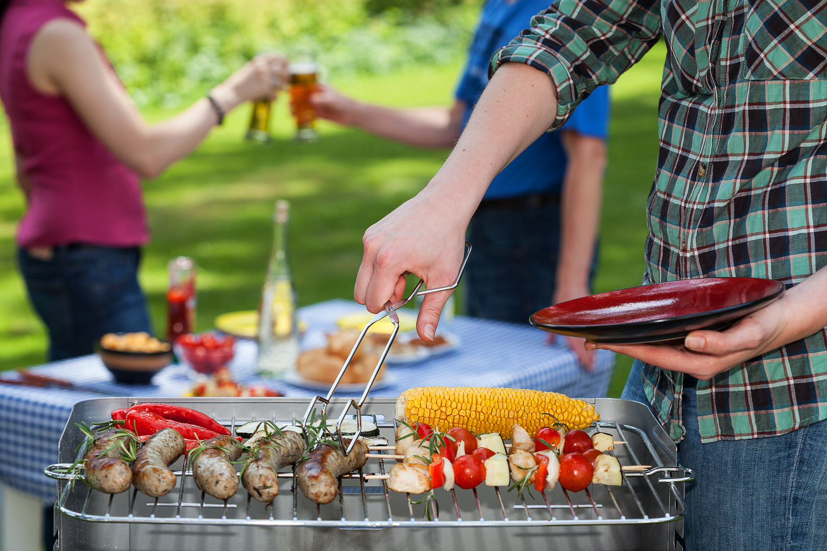 A summer garden paty with grilled snacks and drinks